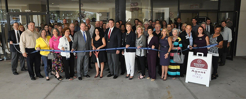 Dewey Mitchell and Allen Crumbley at the ribbon-cutting for the Berkshire Hathaway offices.